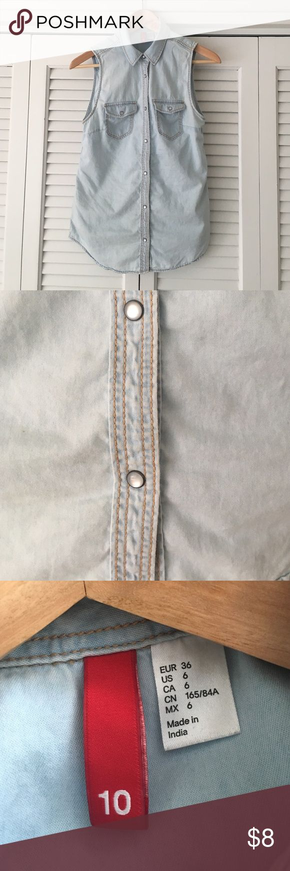Sleeveless denim shirt. H&M. Light blue denim shirt from H&M. Popper fasteners.  US size 6. H&M Tops
