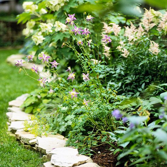 Flagstone Edging Define the space between bed and lawn by stacking rocks. Flagstone and bluestone feature wide, flat faces and lend a romantic English country feeling to a garden. Irregular in shape and thickness, flagstones are durable and stack securely in this garden.