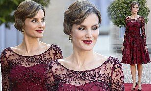 Queen Letizia arrived at the Elysee Palace in Paris in a stunning knee-length plum-coloured frock. The visit marks a year since her husband King Felipe VI took over the Spanish throne from Juan Carlos.