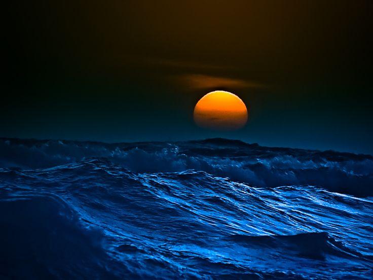 Moon over the ocean.