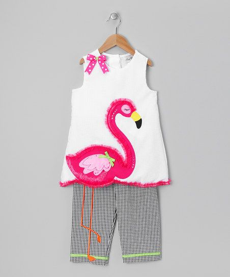 Any little sweetie will look flamingo-fantastic in this stylish and surprising outfit. The ruffle- and sequin-embellished top features a fun flamingo appliqué with legs that go all the way down the matching seersucker capri pants.