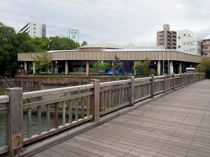 A wooden bridge over the Kotsuki River leads to the Museum of the Meiji Restoration in Kagoshima on Kyushu Island, Japan.