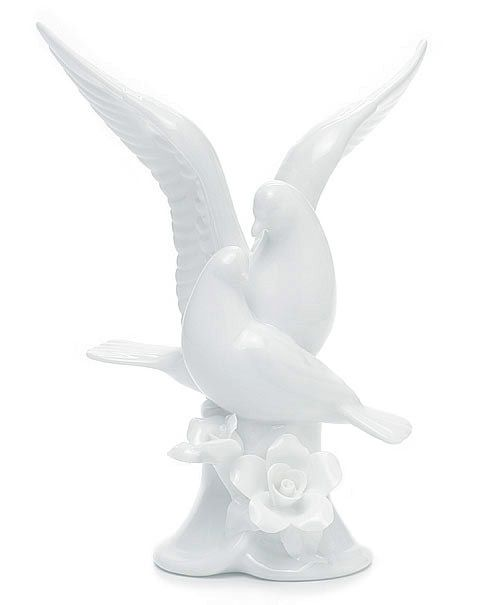 "White Dove Porcelain Cake Topper Size: 6.7""H The dove is a powerful symbol, representing hope, beauty and life. Two doves entwined can add a touch of love to the equation, symbolizing the beauty of mating and of union, joining of two creatures into a single bond. It's an idea of nesting, of family, of unity which is intrinsic to the archetypes we all recognize in the world around us. That's why the white dove porcelain cake topper is such a powerful piece when used on a special occasion suc"