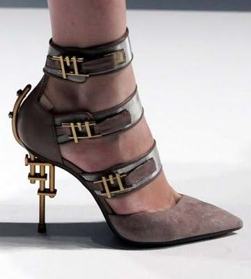 Gianfranco Ferré created these fabulous heels inspired by steampunk brass and buckles. by noemi