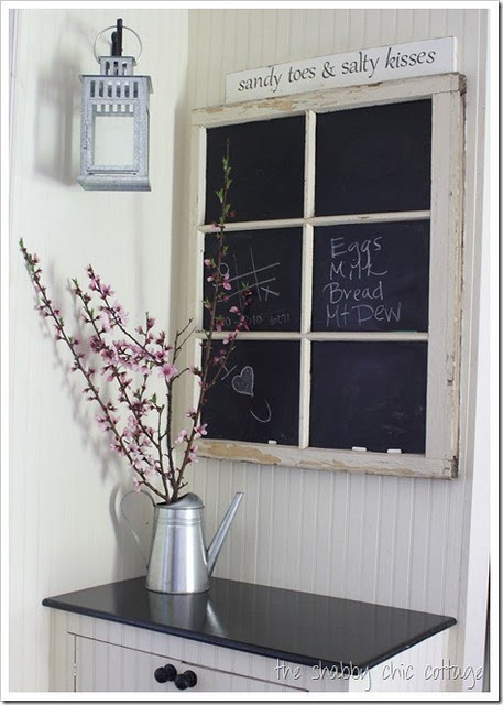 Use chalkboard paint on the panes of an old window. And I love the saying on the sign above