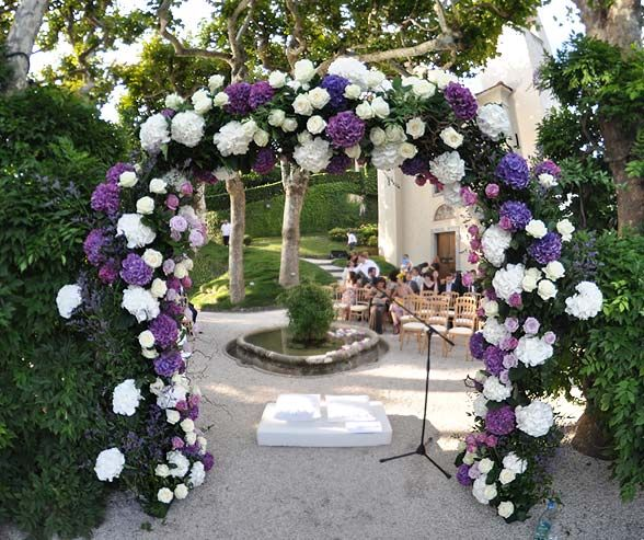 For an outdoor summer ceremony, cover the altar with white and purple hydrangeas and roses.