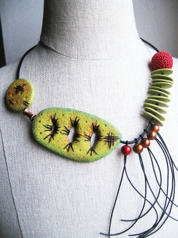 "Asymmetrical polymer clay necklace by ""Ze Cat Is Back""."