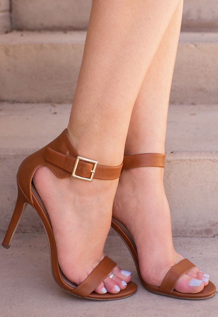Ladylike and elegant! These Giovanna Heels in tan scream just that, and so much more. Features an open-toe style with single strap, ankle strap with side buckle closure. Heel cup. Cushioned heel, rubb