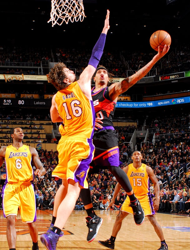 ... Michael Beasley and the Phoenix Suns debuted their black retro jerseys  in a win over the ... 009fbe16f