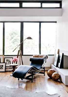 A High End Mid Century Modern Mies Van Der Rohe Chair Serves As Both Art  And Comfort In This Living Room.