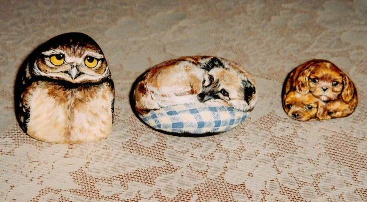 Handpainted on smooth stones.  Owl, my dog princess, and two sweet cocker spaniel puppies.