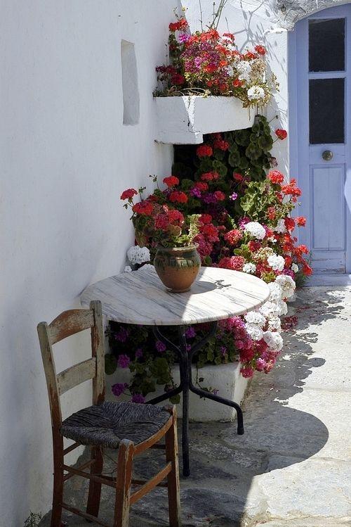 Chora.. Amorgos  Island, Greece- So rustic and beautiful. Red geranium