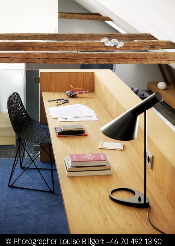 I like both the style of the desk and the wooden beams add a very nice touch.