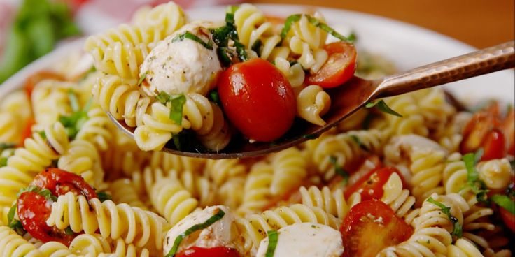 Caprese Pasta Salad. We'll eat anything topped with balsamic drizzle, but especially this.