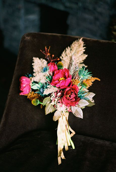 Brides: A Vibrant, Autumn Bouquet with Anemones. A vibrant bouquet made of red anemones, pale-hued astilbe, and greenery, created by Sarah Winward of Honey of a Thousand Flowers.