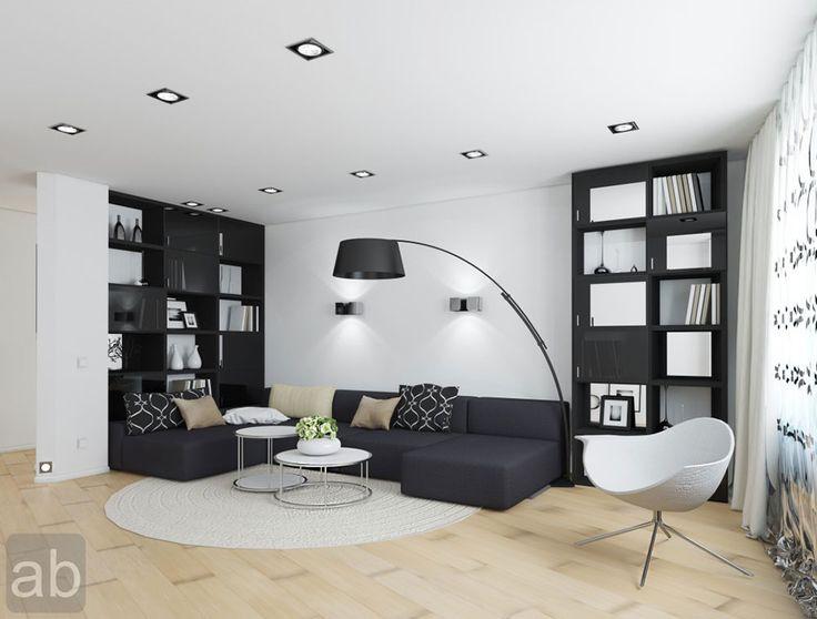 Черно-белый интерьер гостиной в стиле лофт продуман до мелочей.