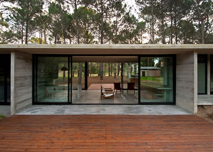 Concrete cabin built in an Argentinian woodland.