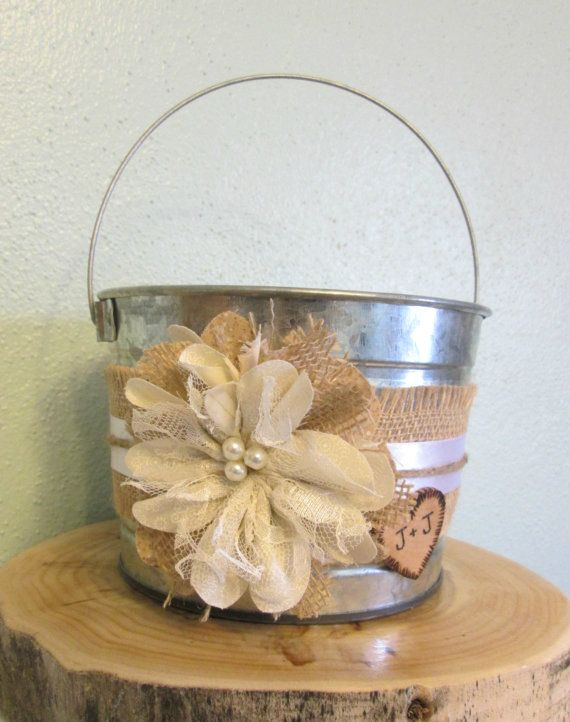 How sweet it will be to see your flower girl walk down the aisle with this unique, rustic bucket. The main feature is a handmade burlap and
