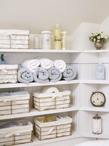 Storage Solutions - Built-in shelves backed with beaded board give the room style and functionality. Corner shelves use every inch of space. Pretty baskets lined with white fabric hold basic bathroom supplies.
