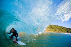 Jordan Kudla, of San Clemente, USA, makes the most of fun waves at a remote beach on Otago Peninsula, Dunedin, New Zealand.