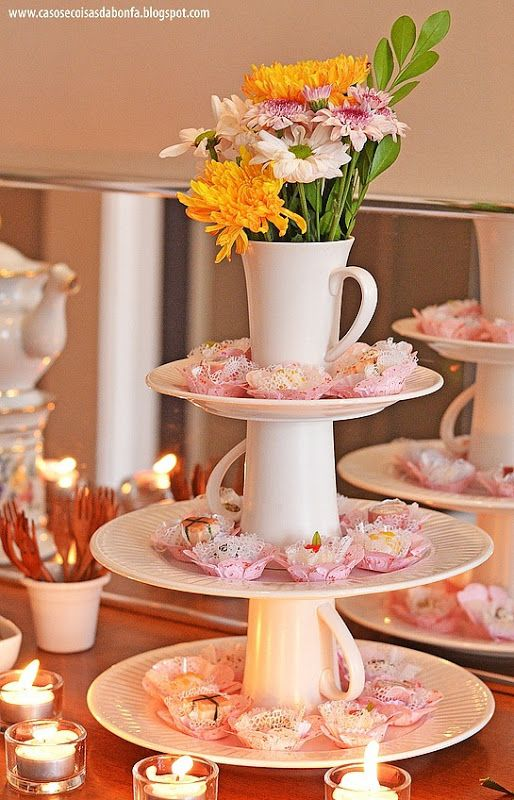 "Pretty way to create tiered candy, cookie,cookie, cupcake displays. A way to use remaining pieces of battered dishwear, thrift shop finds, dollar store junk, party store ""crystal"" and ""silver service"" even paint mismatches for use."