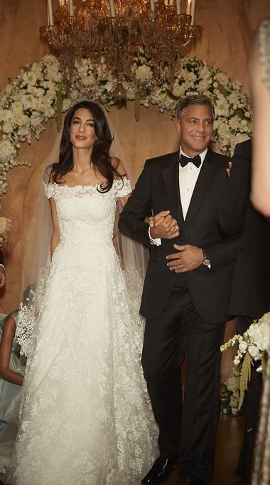Amal Alamuddin and George Clooney Walking Down the Aisle at Their Wedding.