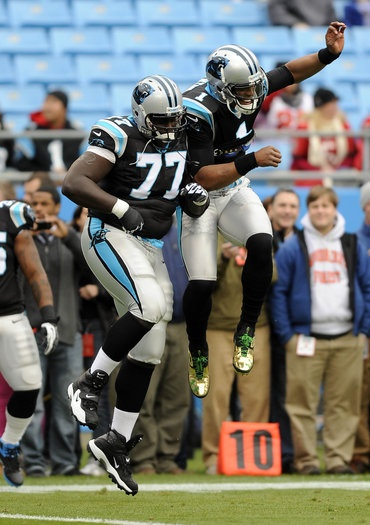 Byron Bell and Cam Newton celebrating