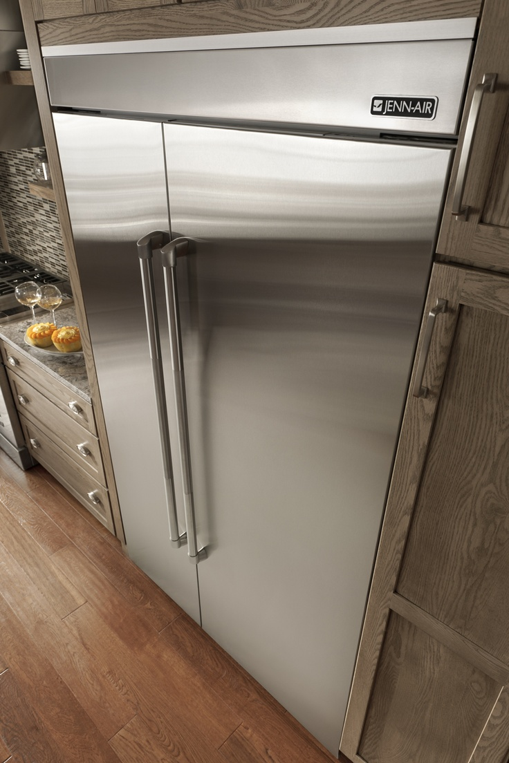 jenn air refrigerator side by side. a dramatic angle showing off the professional look of jenn-air appliance. jenn air refrigerator side by