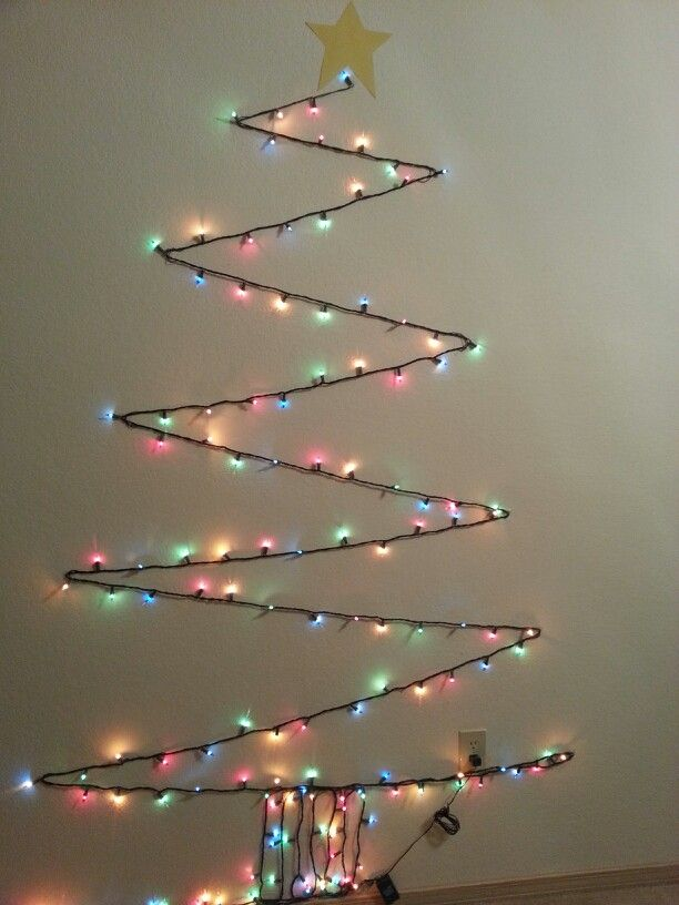 christmas tree out of one strand of lights attached to the wall with clear command hooks super cheap and easy - Cheap Christmas Tree