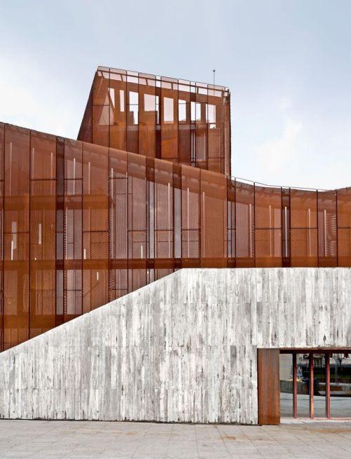 transparent reflective facade over textured concrete