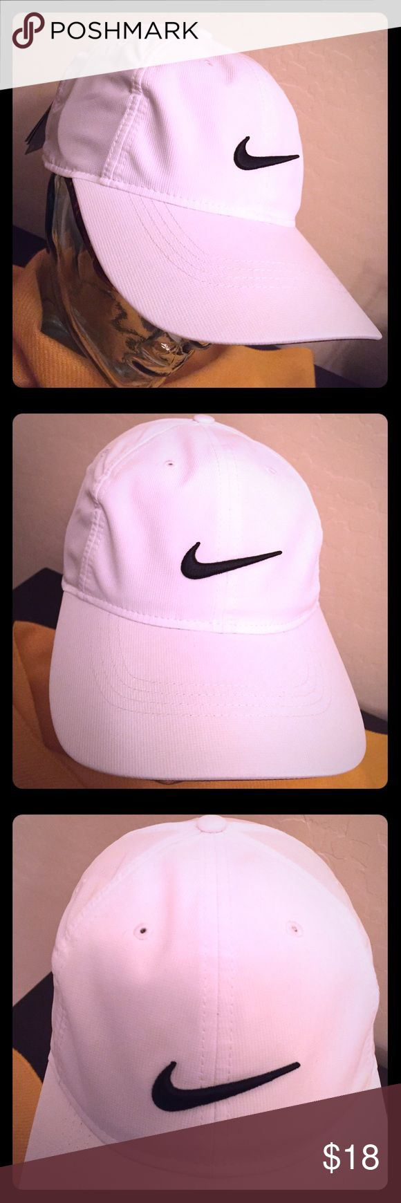 🆕 Nike Golf Adult Unisex Cap Authentic Nike Golf Adult Unisex Cap. OS. White with Embroidered Black Swoosh on the Front & Back. Adjustable Velcro Back. Dri-Fit. Vented. White Button Top. Red Bill. Underbill is Black with White Trim. Partially Lined in Black too. Body & Lining are 100% Polyester. Brand New. Excellent Condition. No Trades. See Other Cool Hats in this Closet. 👌🏽😎👌🏽 Nike Accessories Hats