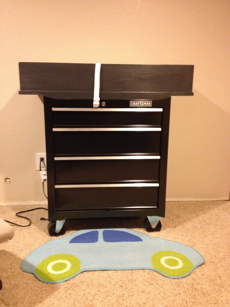Toolbox (craftsmen) changing table made for our son by my wonderful husband! Changing pad is in the black box, you just can't see it. Very functional and goes perfect in a boys nursery.
