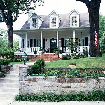 Southern Colonial Style: Characteristics:  -- Steeply pitched gable roof  -- Symmetrical in shape, with centered front door  -- Multipane, tall, double-hung windows  -- Wide, welcoming front porch