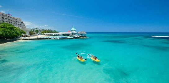 Sandals Ochi Beach Resort in Ocho Rios is our #1 recommendation for a Jamaica honeymoon or destination wedding in Jamaica. This resort is for adult couples only and has over 100 acres, 500 rooms, 4 main pools, 16 dining options, and 11 bars. This Sandals Resort is made up of 3 sections: Seaside, Butler Villas and Great House. #jamaicahoneymoon #allinclusivehoneymoon
