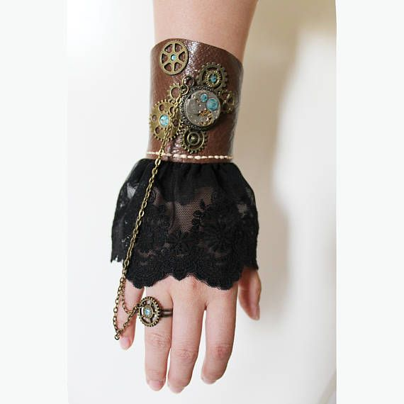 Steampunk laced leather bracer bracelet with ring. With genuine cow leather, used watch, blue rhinestones decor, bronze gears and black lace