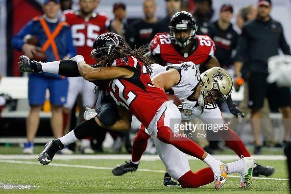 News Photo : Patrick DiMarco of the Atlanta Falcons tackles...