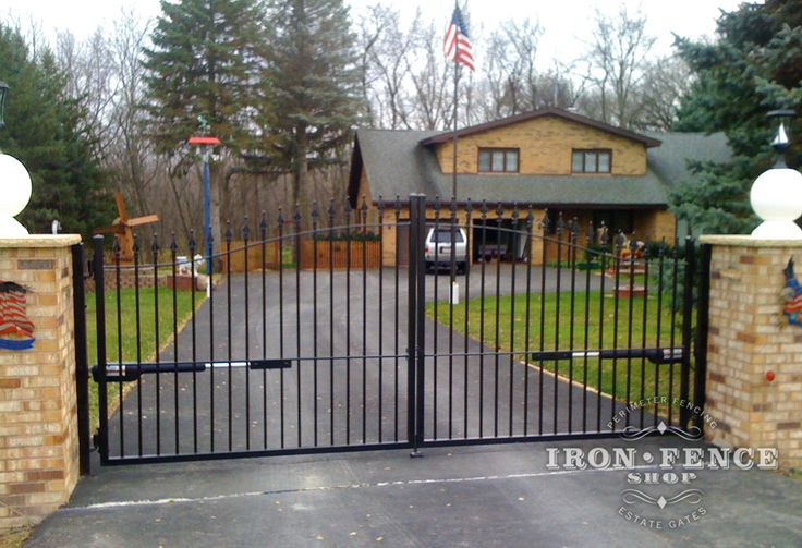 A Wrought Iron Arched Driveway Gate With A Gto Automatic