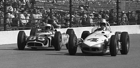 1963 Indy 500. Don Branson in the Leader Card #4 Roadster. Bill Cheesbourg in the #85 Mickey Thompson car. The start of the end of the Roadster era and beginning of the Rear engine era in Indy Car racing