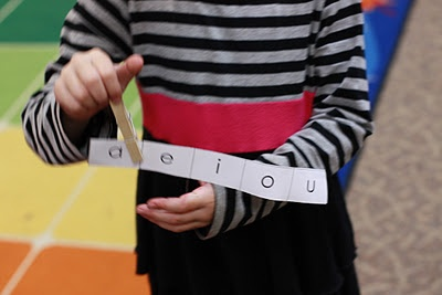 """BRILIANT!! Why didn't I think of this before?! **Vowel Game**  •Each child has a laminated strip of vowels and a clothespin.     •I say a CVC word like """"cat.""""      •The children listen and then put their clothespin on the vowel they hear in the CVC word.   What is so great about this game is that you can have the children hold up their strips and you can quickly check and see who is """"getting it.""""  And best of all, it is fun!-cute!"""