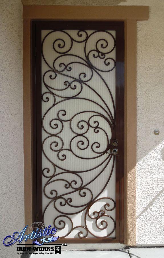 Scrolled wrought iron security screen door