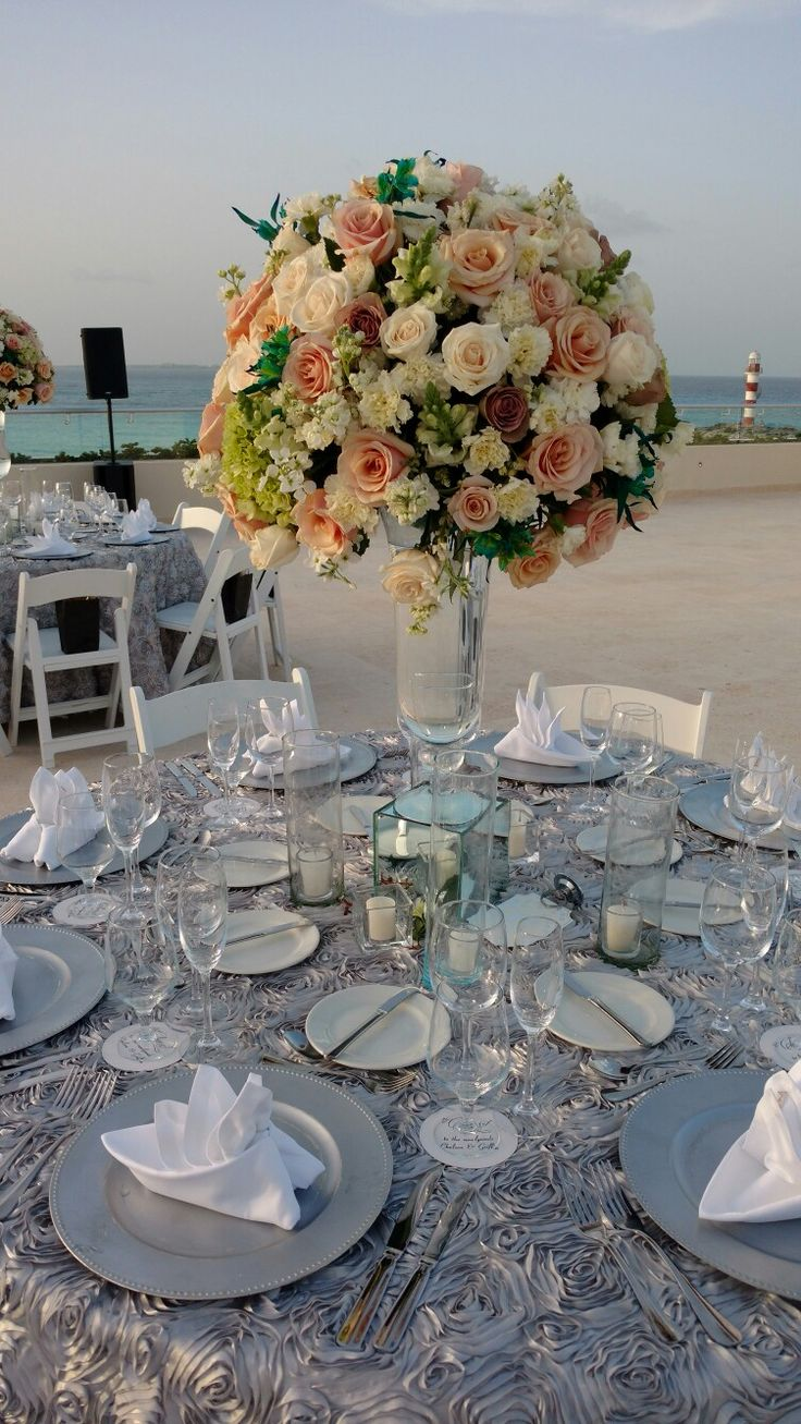 Giant table arrangements  Roses hydrangeas & more