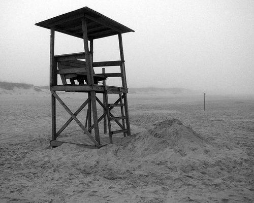 Lifeguard chair and fog on Ocracoke Island, NC beach