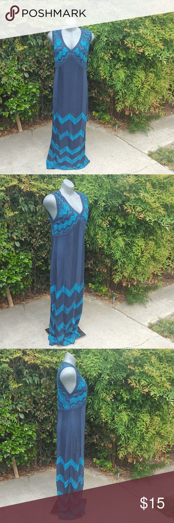 """Missoni Knit Blue Maxi Dress Chevron Size Large Knit dress by Missoni for Target. Two shades of blue, teal & navy. Fabric has lots if stretch.  Navy blue slip is attached.  Chevron print.  See last photos for fabric content and care instructions.  No stains or snagsz.  Please let me know if you have any questions.   Size: Large Chest circumference: 35"""" Waist circumference: 35"""" Sweep circumference: 53"""" Length: 58"""" Strap width: 4"""" Sleeve opening: 10"""" Missoni Dresses Maxi"""