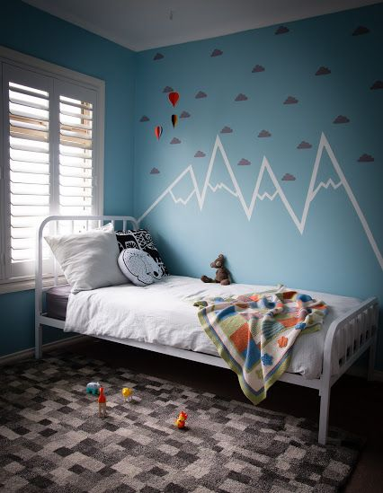Amazing boysroom, complete with handpainted mountain mural.  Cloud wall stickers from Love Mae and hot air balloon mobile complete the dreamy effect.  CamCam bedlinen, cushions by Homely creatures and Marimekko lend a scandi feel.  Styling by Little Nook Interiors