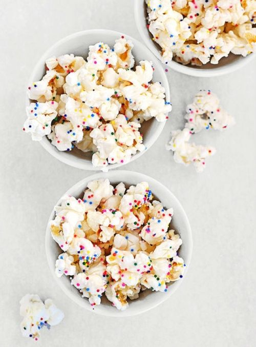 TRIED-This is GREAT..What I did was 16 cups of popped popcorn (on the stove top). Melted 1 bag of white chocolate melts and poured that into my big bowl of popcorn. Mixed well. Dumped the popcorn on two cookie sheets and sprinkled right away with my candies. You must sprinkle fast before the chocolate hardens or it won't stick to the popcorn. Very good. I took this to an 11 year olds birthday party.