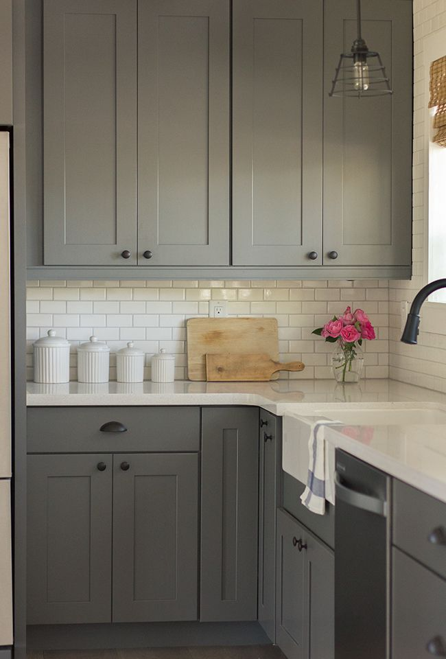 Gray kitchen cabinets (Kraftmaid Durham Maple Square in Grayloft and Dove White), Silestone Quartz white counters (in Marengo and Blanco White), white subway tile backsplash, Feiss urban renewal pendant light | Jenna Sue