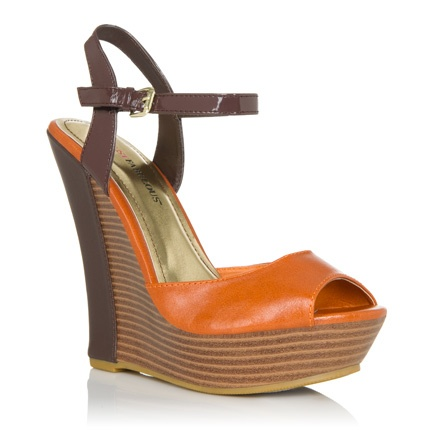 This is the best ever! This versatile peep toe wedge will work wonders for your wardrobe, thanks to her easy-going neutral style.