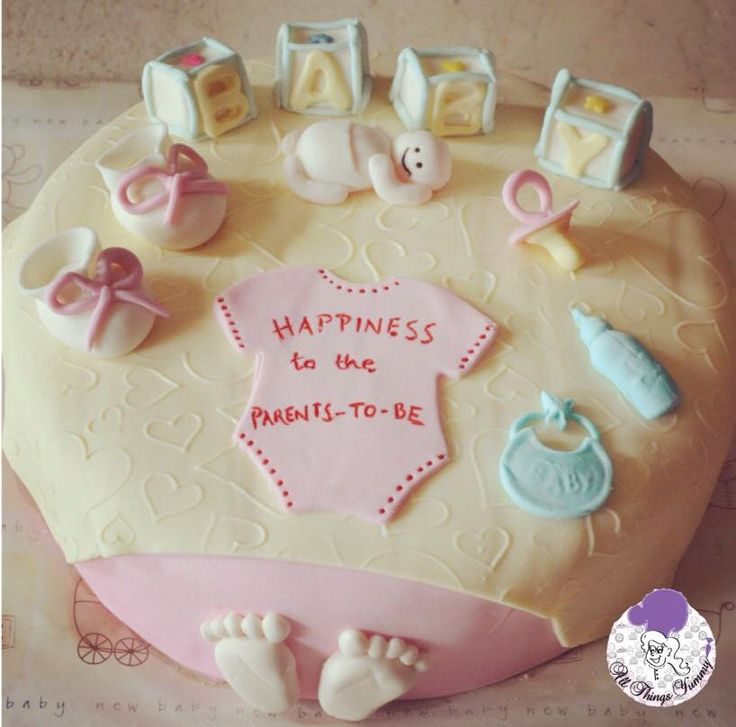 Baby Shower Cakes - Chocolate Truffle Flavored Baby Shower Cake with Baby Toys Decor | All Things Yummy  #allthingsyummy #babyshower #cakes #bibs
