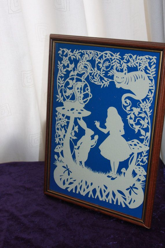 Alice in wonderland handcut papercut framed. Various colour options available. Design credit to bramble crafts, handcut by PaperSpace
