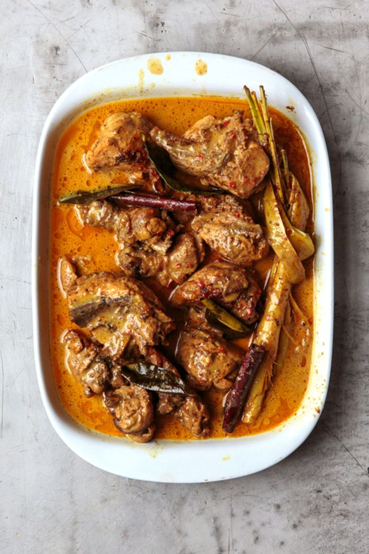 Padang-Style Chicken Curry (Gulai Ayam) 2 tsp. coriander seeds 1 tsp. cumin seeds 1 tsp. fennel seeds 1 tsp. grated nutmeg 1 tsp. ground turmeric 1⁄2 tsp. whole cloves 1⁄4 tsp. cardamom seeds 10 fresh red Thai chiles 5 candlenuts 4 cloves garlic, peeled 3 small Asian shallots, or 1 regular, peeled 1 (2″) piece ginger, peeled and sliced 3 tbsp. peanut oil 5 Kaffir lime leaves 2 sticks cinnamon 1 stalk lemongrass, trimmed and knotted 1 (3 1⁄2–4-lb.) chicken, cut into 8 pieces 2 cups coconut…